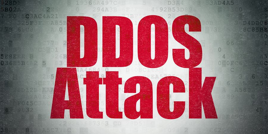 DDoS Attack in red on a white digital background.