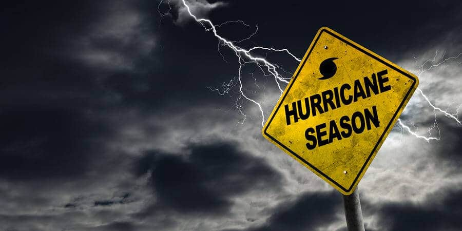 Hurricane season with symbol sign against a stormy background.